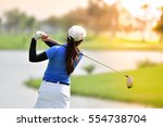 golfer hitting golf shot on... | Shutterstock . vector #554738704