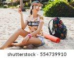 young beautiful woman walking... | Shutterstock . vector #554739910