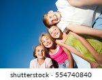 four happy beautiful children... | Shutterstock . vector #554740840