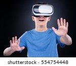 amazed teen boy wearing virtual ... | Shutterstock . vector #554754448