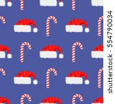 vector red hat and candy cane...   Shutterstock .eps vector #554790034