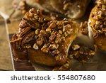 homemade glazed pecan sticky... | Shutterstock . vector #554807680