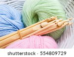 pastel colored yarn in white... | Shutterstock . vector #554809729