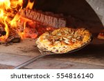 mushroom pizza being pulled... | Shutterstock . vector #554816140