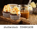 homemade butterscotch cupcakes... | Shutterstock . vector #554841658