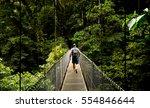 man walking on a hanging bridge ...   Shutterstock . vector #554846644