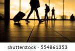 travellers in airport walking... | Shutterstock . vector #554861353