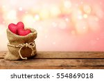 two red heart in burlap sack on ... | Shutterstock . vector #554869018
