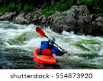 A Whitewater Kayaker Braces In...