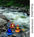 Three Whitewater Kayakers...