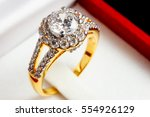 close up gold diamond ring in... | Shutterstock . vector #554926129