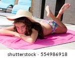pretty girl posing on the towel ... | Shutterstock . vector #554986918