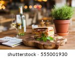 big  tasty sandwich with ham ... | Shutterstock . vector #555001930