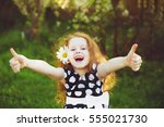 funny girl with daisy in her... | Shutterstock . vector #555021730