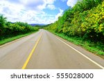 road  and blue sky with clouds  | Shutterstock . vector #555028000