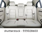 Back passenger seats in modern luxury car, frontal view, white leather - stock photo