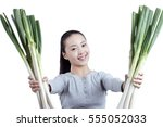 young woman holds a bunch of...