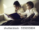 cute little sisters reading a... | Shutterstock . vector #555055804