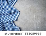Blue Folded Tablecloth On Gray...