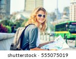 happy young woman with a city... | Shutterstock . vector #555075019