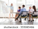 cheerful business coach... | Shutterstock . vector #555085486