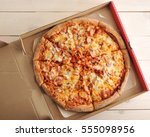 pizza with cheese and spicy... | Shutterstock . vector #555098956
