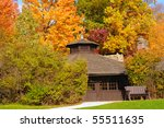 Close view of a rustic park shelter in Cuyahoga Valley National Park with brilliant autumn foliage - stock photo