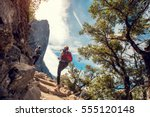 two lady hikers on the walkway... | Shutterstock . vector #555120148