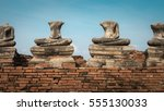 damaged ancient buddha at... | Shutterstock . vector #555130033
