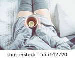 girl is drinking hot tea on the ... | Shutterstock . vector #555142720
