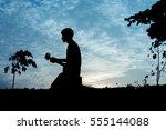 Silhouette Musician Kneeling...