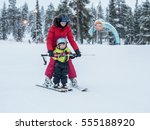 Child Learn Skiing In The...