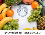 stack of fruits over white... | Shutterstock . vector #555189160