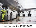 large plane at airport during... | Shutterstock . vector #555197470