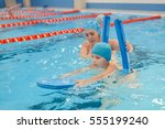 mother giving son a swimming... | Shutterstock . vector #555199240