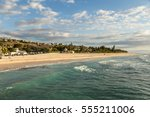 early sunset over the beach in... | Shutterstock . vector #555211006