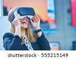 Stock photo young woman wearing virtual reality device 555215149