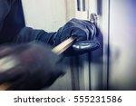 Masked Burglar With Crowbar...