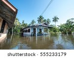 house in floodwater.... | Shutterstock . vector #555233179