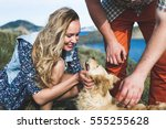Stock photo people playing with dog outside by the nature happy smile of girl 555255628