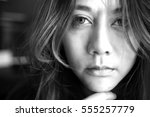 Stock photo close up face beautiful young woman lonely looking fear about the past depressed in black and 555257779