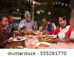 multi generation family eating... | Shutterstock . vector #555281770