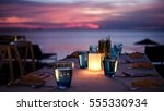 dining table in the sunset... | Shutterstock . vector #555330934