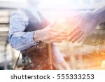 business handshake. business... | Shutterstock . vector #555333253