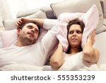 picture of angry woman in bed... | Shutterstock . vector #555353239
