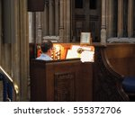 Small photo of BRISTOL, UK - CIRCA SEPTEMBER 2016: Organist at St Mary Redcliffe Anglican parish church