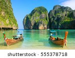 longtail boats anchored at maya ... | Shutterstock . vector #555378718