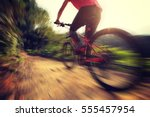 young woman riding mountain...   Shutterstock . vector #555457954
