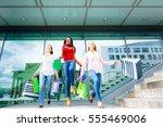 young women shopping | Shutterstock . vector #555469006