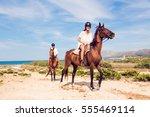 Stock photo young tourist couple horseback riding 555469114